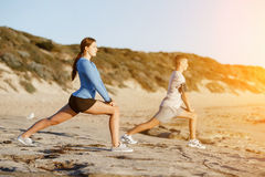 Young couple on beach training together Stock Photography