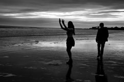 Young couple on the beach in winter Stock Images