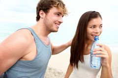 Young couple beach workout Royalty Free Stock Photos