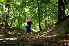 Young couple in Beautiful forest Koprivnice. Young tourists couple in Beautiful Koprivnice forest, near old ruins of Sostyn castle. Beautiful Czech landscape Royalty Free Stock Photo