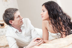 Young couple on a bed stock images