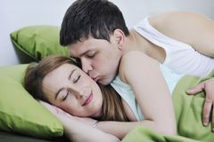 Young couple in bed Royalty Free Stock Images