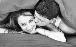 Young couple in bed Stock Photos