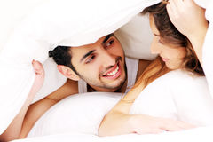 Young couple in bed Royalty Free Stock Photos