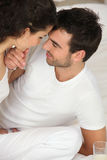 Young couple on the bed Stock Images