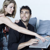 Young couple in a bed Royalty Free Stock Photo