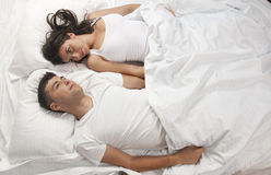 Young couple in bed Stock Photography