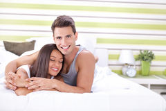 Young couple in a bed Stock Images