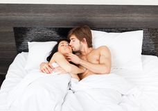 Young couple bed Stock Photos
