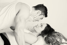 Young couple in bed. Couple in bed, black and white Stock Image