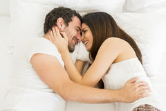 Young couple in the bed Stock Photo