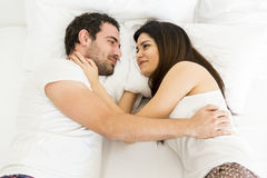 Young couple in the bed Stock Images