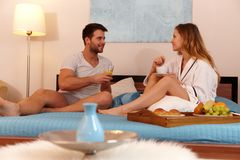 Young couple in bed having breakfast stock photo