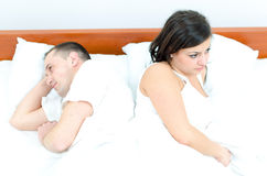 A young couple in bed Stock Photos