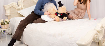 Young couple on the bed Royalty Free Stock Photo