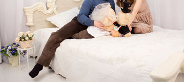 Young couple on the bed Royalty Free Stock Photos
