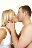 Young couple in bed, kissing Stock Photos