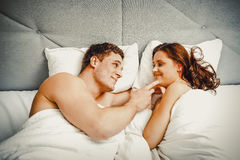 Young couple in bed. royalty free stock photography