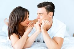 Young couple in the bed. Young loving couple in the bed Stock Images