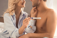 Young couple on bed pregnancy test check. Happy pregnant