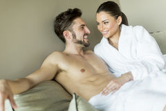 Young couple on the bed. Young couple relaxing on the bed Stock Photography