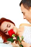 Young couple in bed with a rose Stock Photos