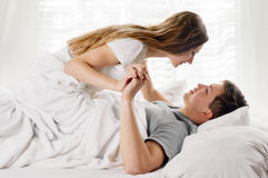 Young couple in bed Stock Image