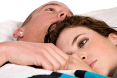 Young couple in bed thinking their thoughts Stock Photo