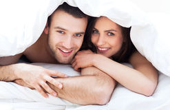 Young couple in bed Royalty Free Stock Image