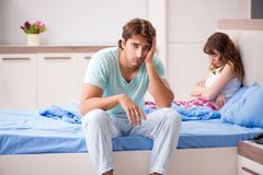The young couple in the bedroom royalty free stock images