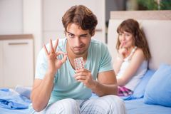The young couple in the bedroom stock photography