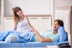 The young couple in the bedroom royalty free stock image