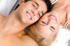 Young couple in bedroom Stock Image