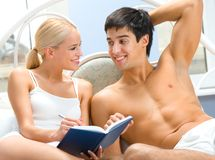 Young couple in bedroom Royalty Free Stock Images