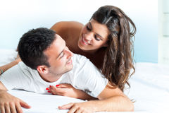 Young couple in bedroom. Royalty Free Stock Photography