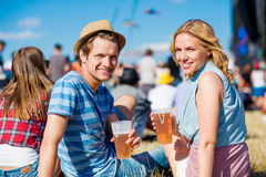 Young couple with beer at summer music festival Stock Image