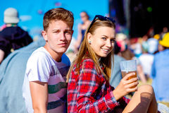 Young couple with beer at summer music festival Stock Photo