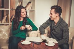 Young couple behind table discussing Stock Images