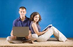 Young couple on beige carpet Royalty Free Stock Image
