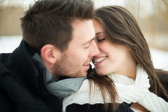 Young couple being affectionate in winter Royalty Free Stock Photo
