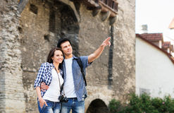 Young couple being tourists exploring the medieval buildings Royalty Free Stock Photos