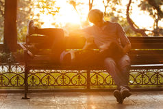 Young couple on the bench at the street. Stock Photos
