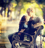 Young couple on the bench at the street. Royalty Free Stock Photography