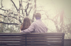 Young couple on the bench at the street. Royalty Free Stock Photos
