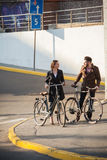 Young couple with on a bicycle opposite city Stock Images