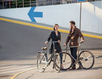 Young couple with on a bicycle opposite city Royalty Free Stock Image