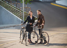 Young couple with on a bicycle opposite city Royalty Free Stock Photography