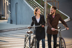 Young couple with on a bicycle opposite city Stock Photos