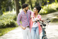 Young couple with a bicycle Stock Photos