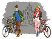 Young couple with bicycles on city background Stock Image